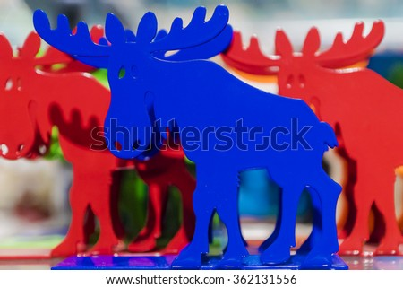 colored animal moose souvenir from Sweden - stock photo