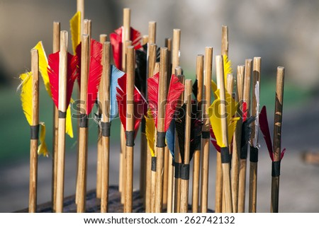 Colored arrows waiting to get shot at the target - stock photo