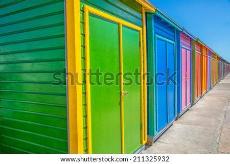 colored beach huts - stock photo