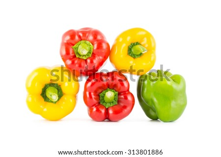 Colored bell peppers on over white background