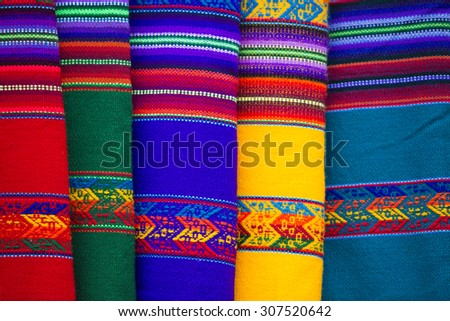 Colored blankets for Sale in Salar of Uyuni tourist market. Bolivia - stock photo