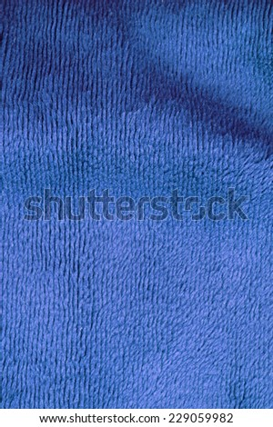 Colored blue faux fur texture background - stock photo