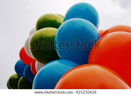 Colored blue, white, orange and green balloons