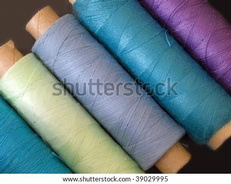 colored bobbins - stock photo