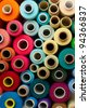 colored bobbins background. red, orange, blue and yellow colors - stock photo