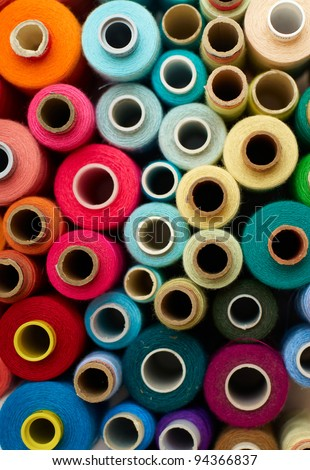 colored bobbins background. red, orange, blue and yellow colors
