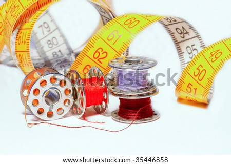 Colored bobbins for machine sewing - stock photo