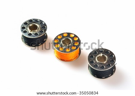 colored bobbins for sewing machines - stock photo