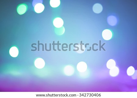 Colored bokeh background with vignette effect - stock photo