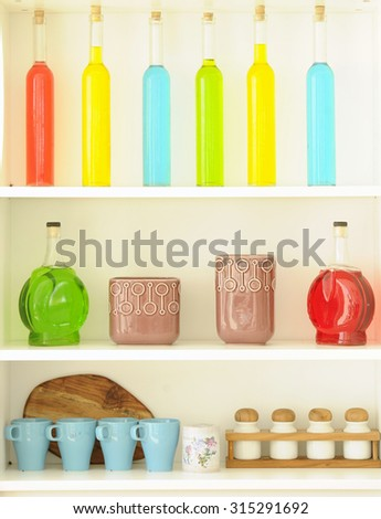 Colored bottles arranged nicely on the shelf