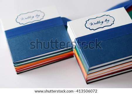 Colored boxes for CDs with photos. With embossing and cutting. Decorated with ribbon.
