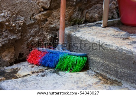 Colored broom on the street - stock photo
