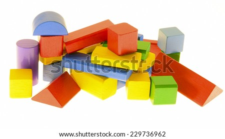colored building bricks on a white surface