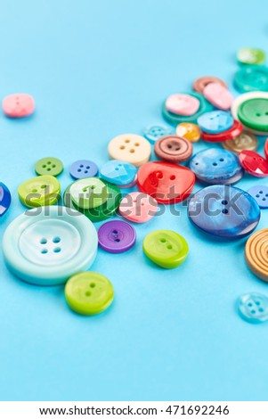 Colored buttons on paper background