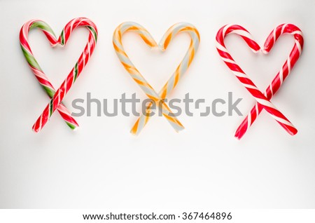 colored candy in heart shape on white background,valentines day