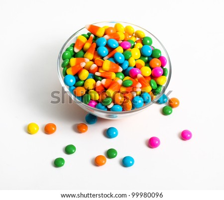 Colored candy inside glass bowl - stock photo