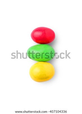 colored candy laid out in a series of carved on a white background - stock photo