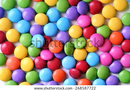 Colored candy smarties texture pattern background - stock photo