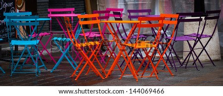 colored chairs in French market - stock photo