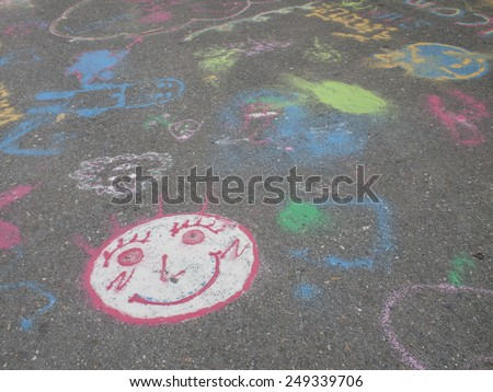 Colored chalks. Colored chalk on playground with drawings on street - stock photo