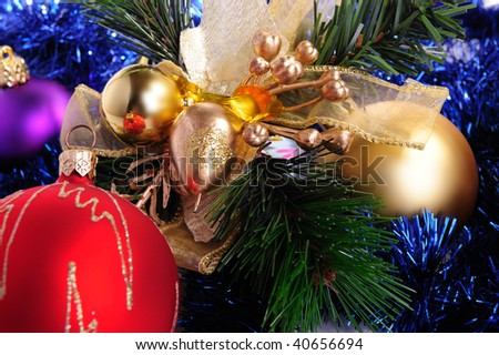 Colored Christmas balls with fir branches