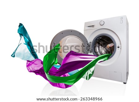 Colored cloth flying from washing machine, isolated on white background - stock photo