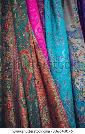 Colored cloth on the Eastern market, a stall with goods - stock photo
