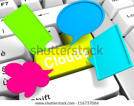 colored clouds above the keyboard in a symbolic way - stock photo