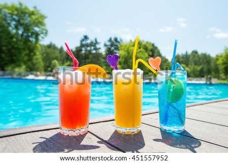Colored cocktails on a background of water