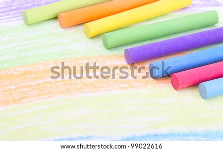 Colored crayons on paper - stock photo