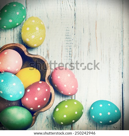 colored Easter eggs on wooden background. Focus on blue wooden background. toned photo - stock photo