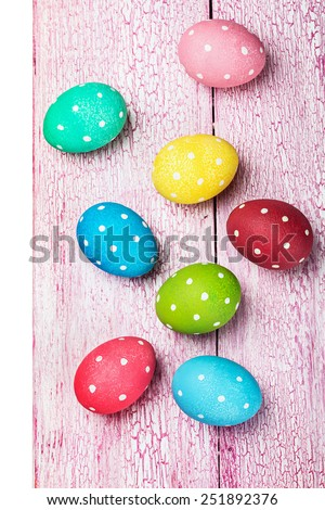 colored Easter eggs on wooden background. Isolated on white background - stock photo