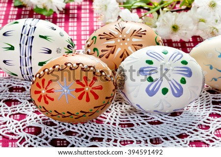 Colored easter eggs with blossom on the table