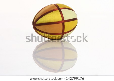 colored egg, colored linen egg to decorate and playing on a white background - stock photo