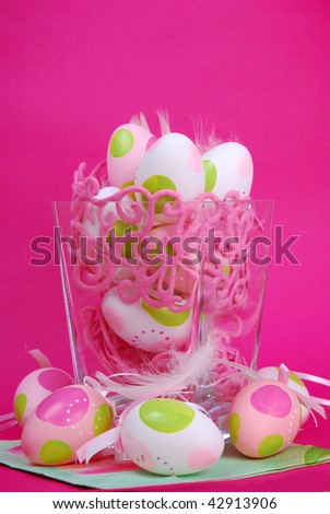 colored eggs and rabbit as easter decoration on pink background