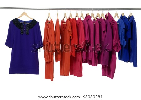 colored fashion cloth hanging on hangers - stock photo
