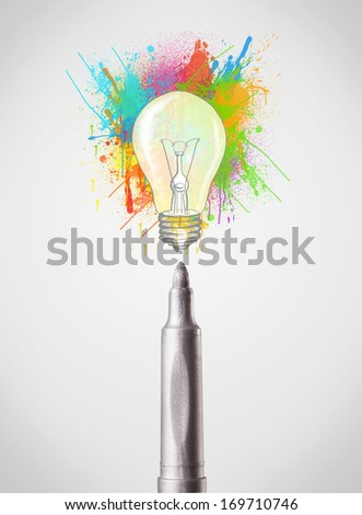 Colored felt pen close-up with colored paint splashes and lightbulb concept - stock photo
