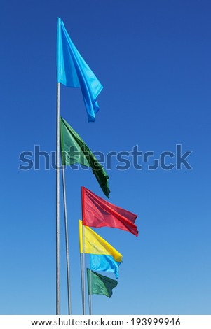 Colored flags on sky background - stock photo