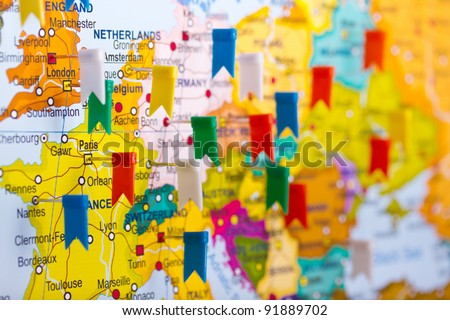 Colored flags on the map of Europe - an interesting travel plan - stock photo