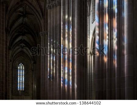 Colored flecks from windows on the columns of the Batalha Santa Maria da Vitoria Dominican abbey, Portugal - stock photo
