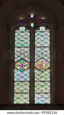 Colored flecks of sunlight on the columns of the Batalha Santa Maria da Vitoria Dominican abbey - Portugal - stock photo