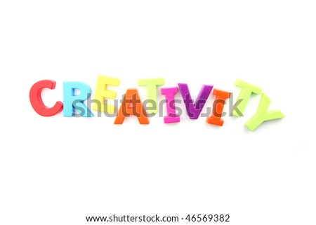 Colored fridge magnets spelling out 'creativity' on a white background