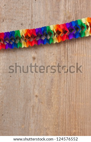 Colored garland in front of a wooden board