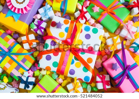 Colored gift boxes with colorful ribbons. Yellow background. Gifts for Christmas or a birthday.