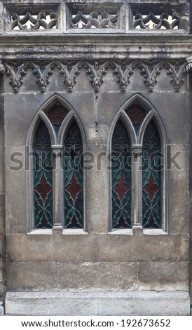 Colored glass in the windows of the old Gothic building - stock photo
