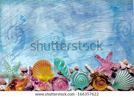 Colored glass shells on textured background