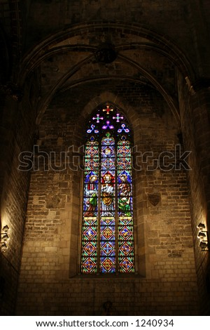 "colored glass window in the gothic church  ""santa maria del mar""  in Barcelona. Spain. - stock photo"