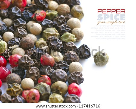 Colored grains of pepper, close-up on a white background - stock photo