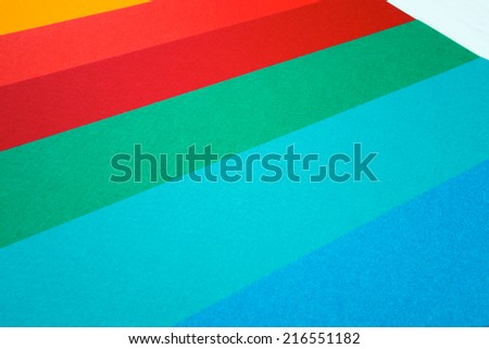 Colored group of empty papers on office desk for notes - stock photo