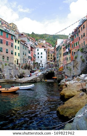 Colored houses and the small marina of Riomaggiore, Cinque Terre - stock photo